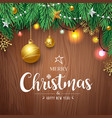 merry christmas pine leaves and gold ball vector image vector image