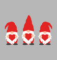 Cute gnomes with hearts in red hats for valentine