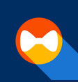bow tie icon white icon on tangelo circle vector image vector image
