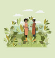 couple planting tree in the park vector image vector image