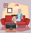 grandmother is reading a book to her granddaughter vector image vector image