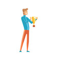 handsome young sportsman holding winner trophy vector image vector image