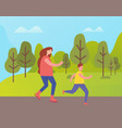 mother and son jogging in park among green trees vector image vector image