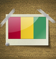 Flags Guinea at frame on a brick background vector image