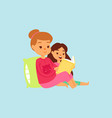 mother or older sister in pink night-suit reading vector image vector image