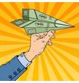 pop art hand throwing dollar paper plane vector image vector image