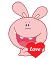 pink rabbit laughing and holding a red heart vector image vector image