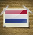 Flags Netherlandsat frame on a brick background vector image