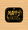 Golden Happy Easter lettering on wooden background vector image vector image