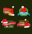 four christmas sale posters with pretty red hats vector image