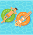 man and woman floating on inflatable circles vector image vector image