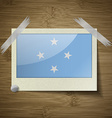 Flags Micronesia at frame on wooden texture vector image vector image