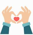 hand making a heart shape vector image vector image