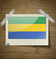 Flags Gabon at frame on wooden texture vector image