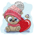 cute cartoon teddy in a knitted cap vector image vector image