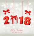 new year background with a 2018 and a gift box vector image