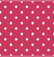 white dot seamless pattern on red vector image