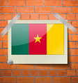 Flags cameroon scotch taped to a red brick wall vector image vector image