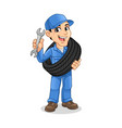 mechanic man carrying tire and holding wrench vector image vector image