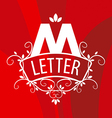 ornate letter M logo on a red background vector image vector image