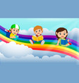 happy children reading book over the rainbow vector image