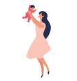 a young mother stands and plays with her child in vector image vector image