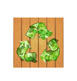 recycle sign on wooden background vector image vector image