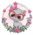 cartoon gray kitten with a floral wreath vector image vector image