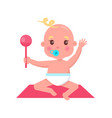 little baby with pacifier and rattle sits on rug vector image vector image