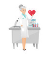 caucasian cardiologist holding a big red heart vector image vector image