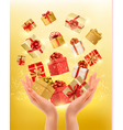 Holiday background with hands holding gift boxes vector image vector image