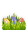 colorful decorated easter eggs in fresh green vector image vector image