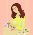 girl sews a toy vector image