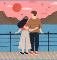 couple hugging standing on waterfront admiring vector image vector image