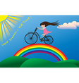 A little girl riding a bike on a rainbow vector image