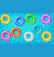 set of swimming rings floating in the blue water vector image