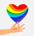 human hand hold rainbow heart lgbt concept vector image