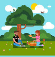happy couple of young people on a picnic picture vector image