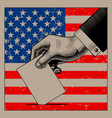 hand putting voting paper on the usa flag vector image vector image