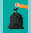 plastic garbage bag with rope in hand vector image vector image