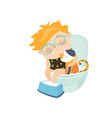 little boy is sitting on the toilet vector image