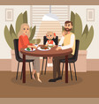 a married couple with a child is having breakfast vector image