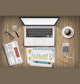 laptop with white screen and stationery on table vector image