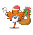 santa with gift red maple leaf mascot cartoon vector image