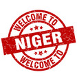 welcome to niger red stamp vector image vector image