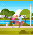 man give girl gift and bouquet over green park vector image vector image