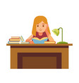 girl sits at table with books and reads vector image vector image