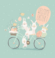 easter bunnies riding on bike with easter eggs vector image vector image