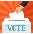 hand putting voting paper in ballot box political vector image