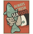 seafood with fish in hand vector image vector image